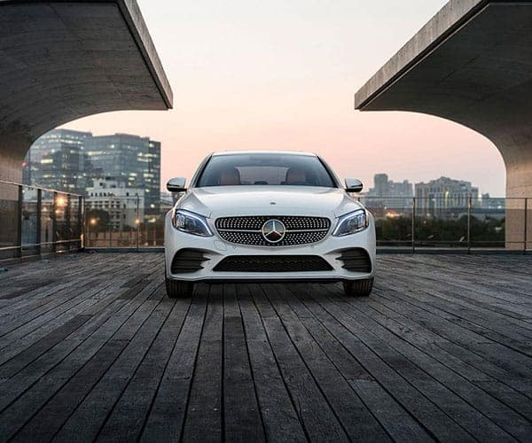 White 2019 Mercedes-Benz C-Class on Wooden Platform in City