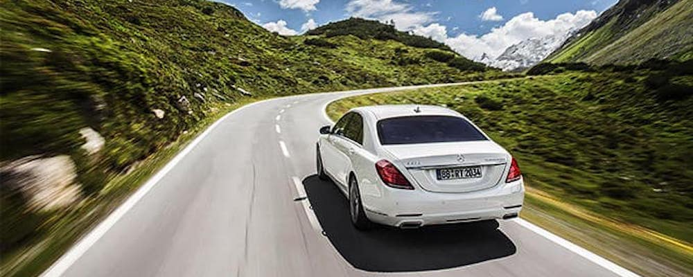 White Mercedes-Benz on the road