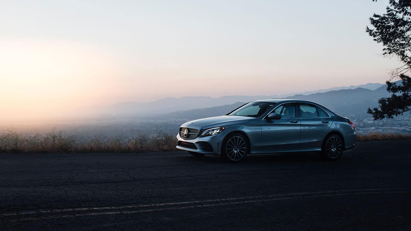 2019 Mercedes-Benz C-Class driving at dusk