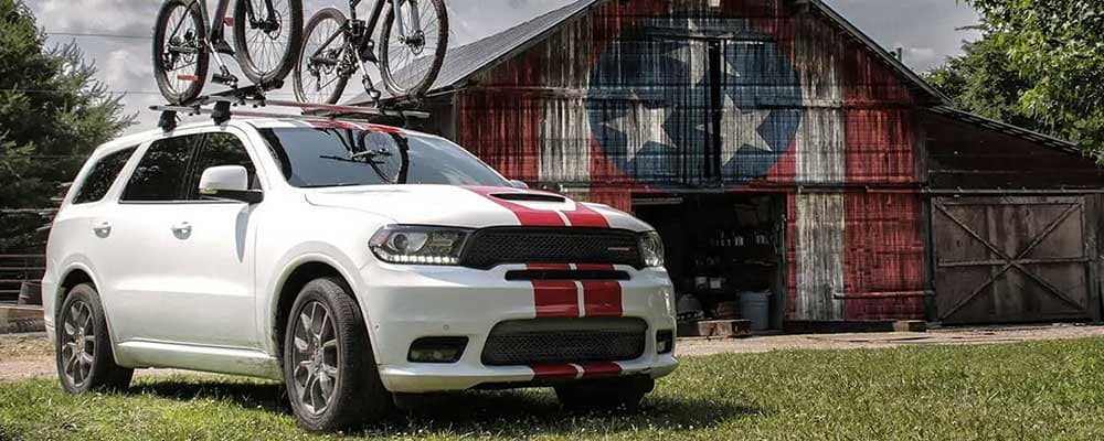 2019 Dodge Durango parked in front of shed