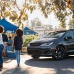 Black 2020 Chrysler Pacifica in parking lot tailgate