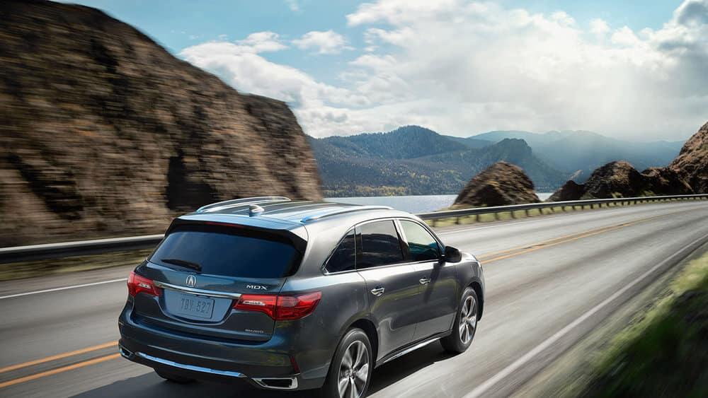 2017 Acura MDX SH AWD Advance Modern Steel Metallic driving by mountain lake