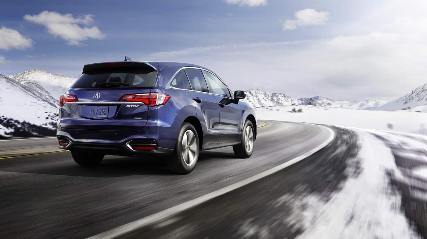 Acura RDX driving on snow covered road