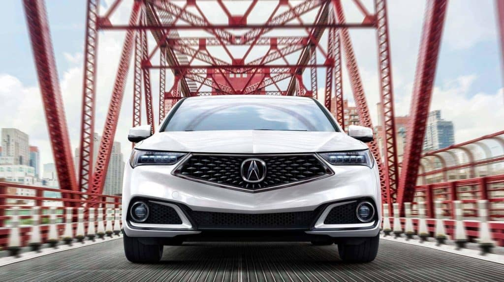 Front Grille of 2018 TLX driving on a Bridge
