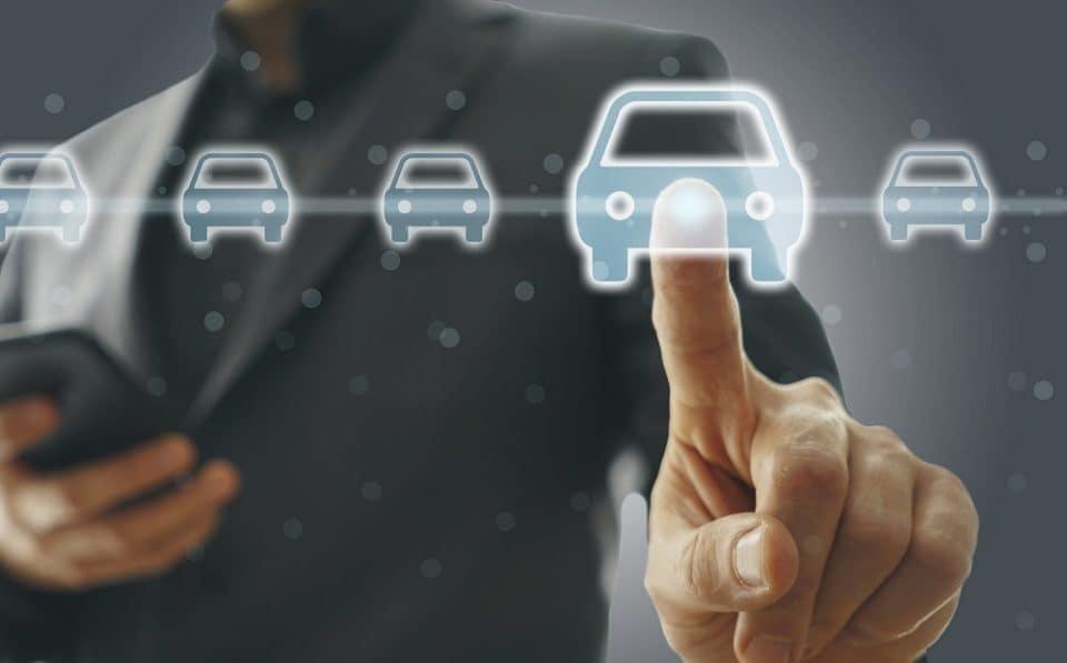Man selecting car from a virtual screen