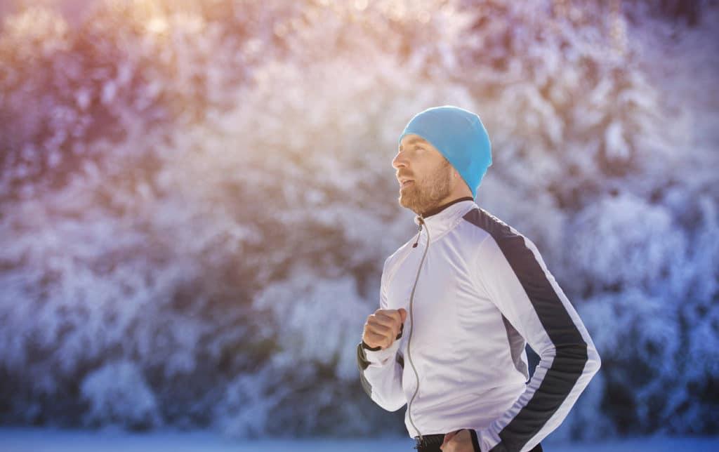 Man running outside in winter
