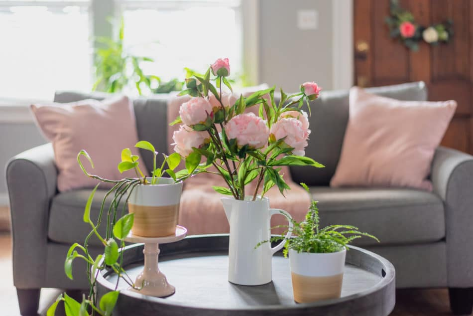 Living room decorated for spring with pink and green flowers