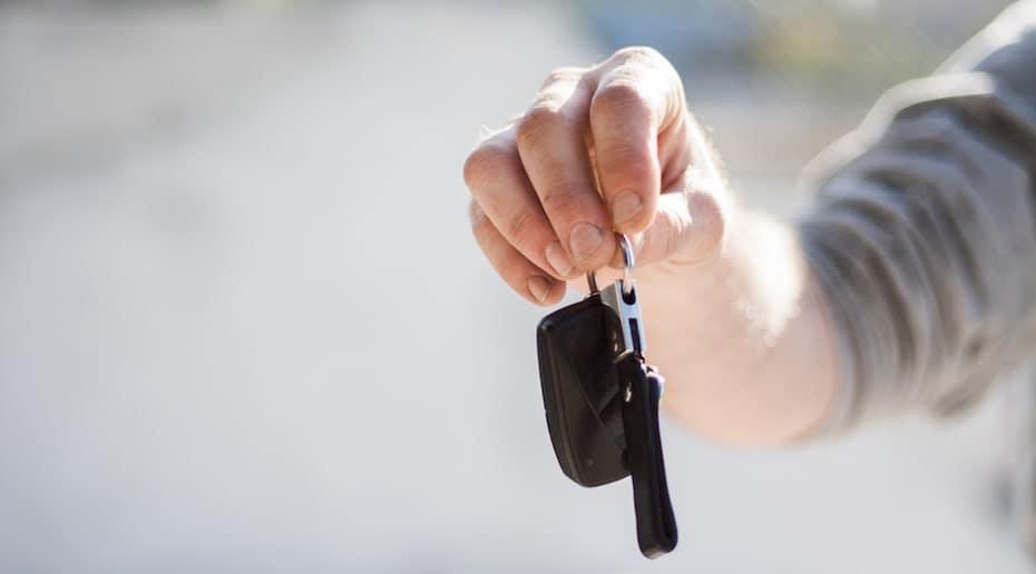 A man dangling a set of car keys