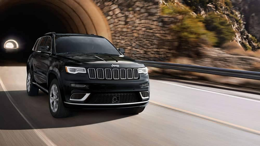 2019 Jeep Grand Cherokee emerging from tunnel