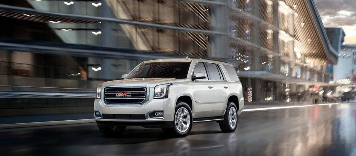 2018 GMC Yukon on rain-swept streets