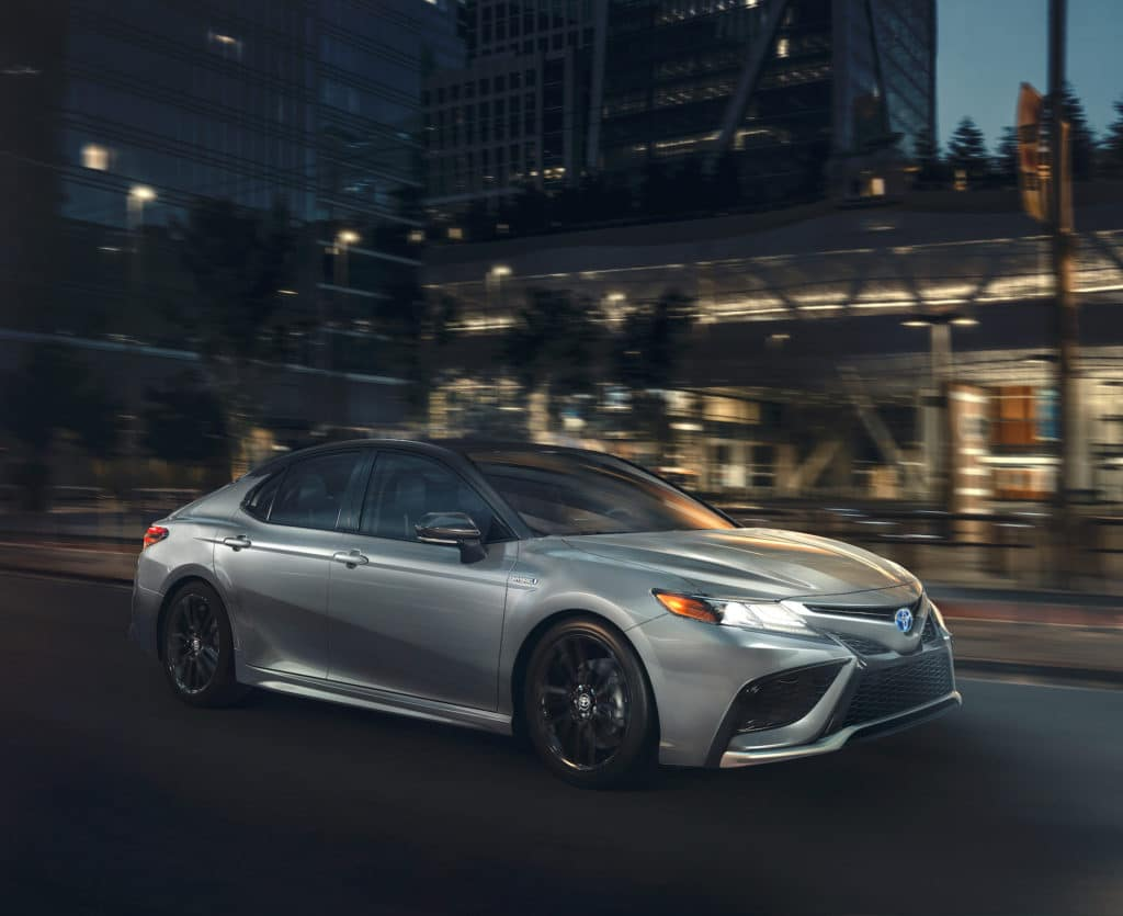 A Toyota Hybrid for Everyone at Penn Toyota | 2021 Toyota Camry Hybrid on road at night