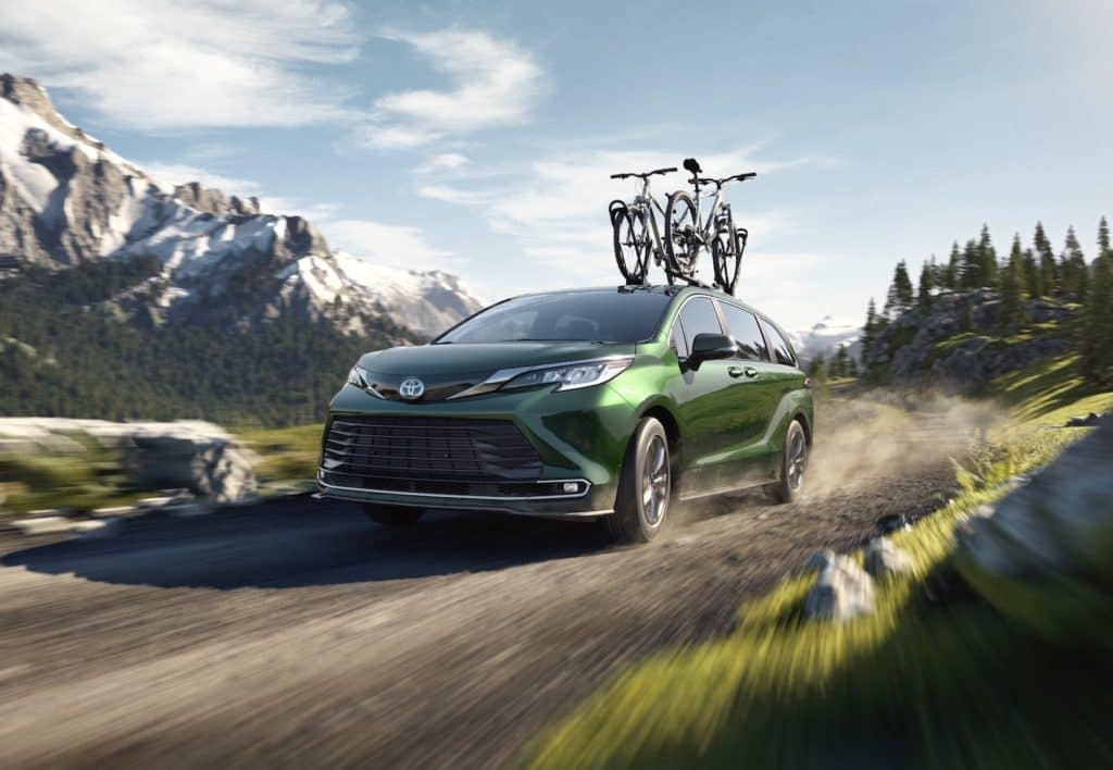 A Toyota Hybrid for Everyone at Penn Toyota | 2020 Toyota Sienna Hybrid driving on mountain trail with bike on roof