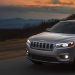 2019 Jeep Cherokee SUV silver driving on rural road