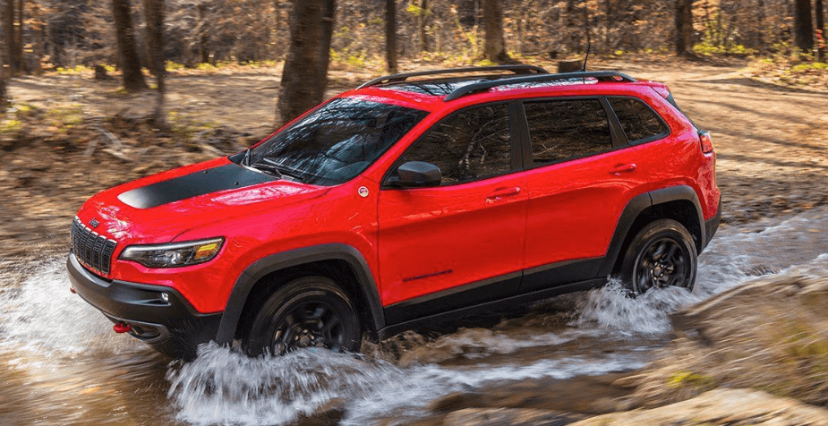 red Jeep Cherokee driving in high water