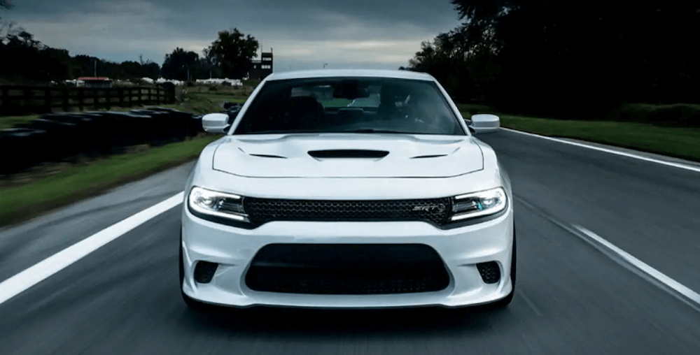 white dodge charger driving