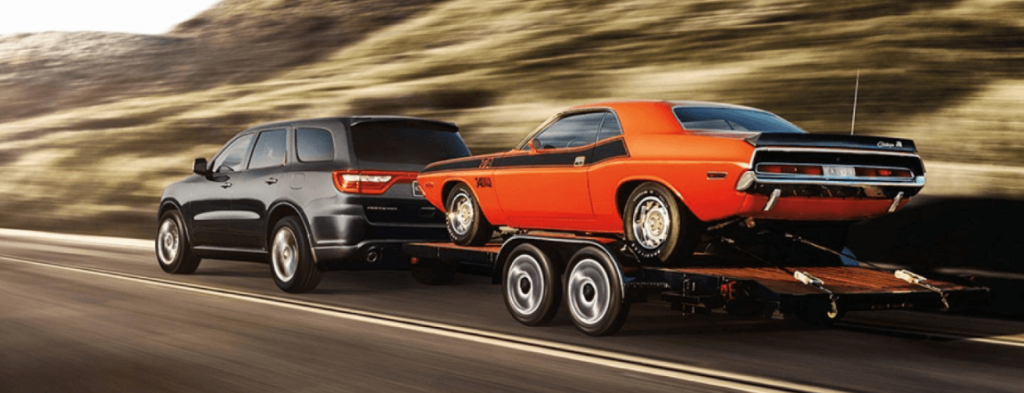 2020 Dodge Durango towing trailer with old car