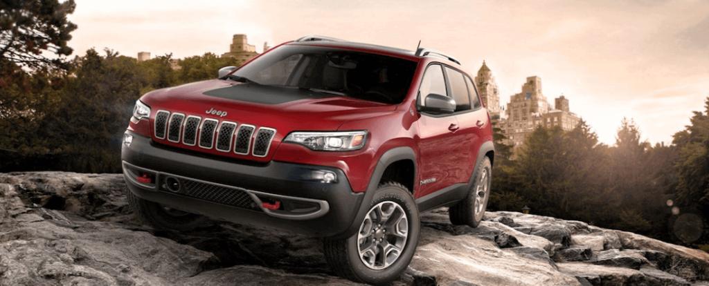 2020 Jeep Cherokee Trailhawk trim level offroading on rocky terrain