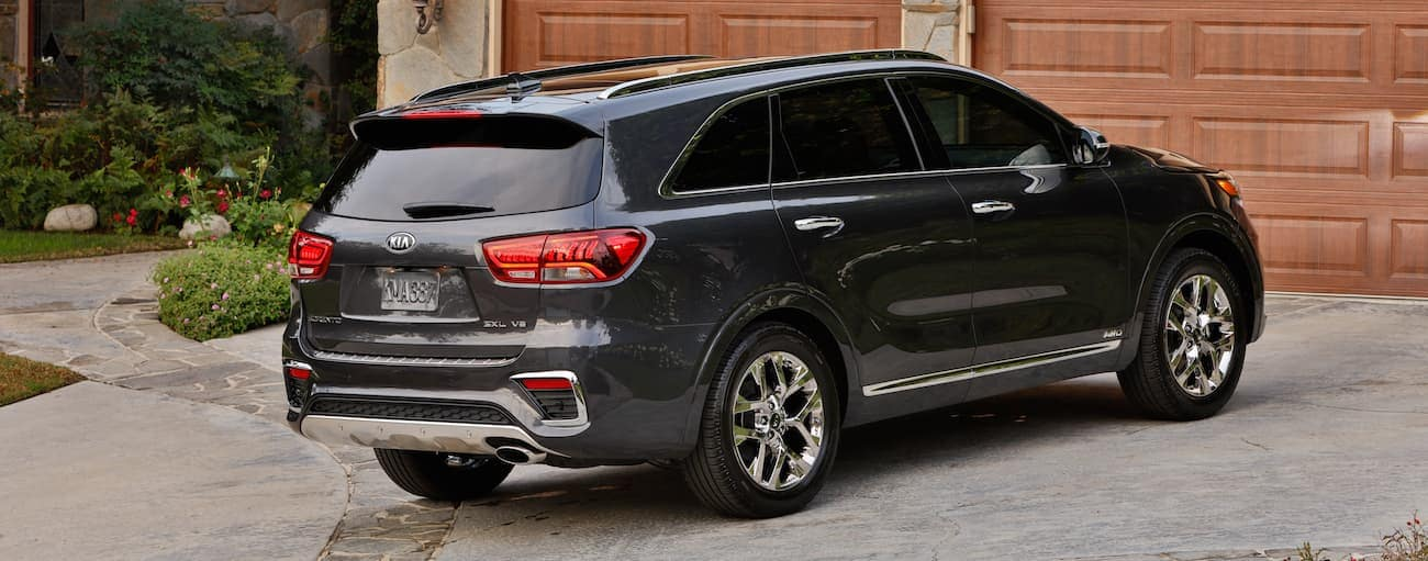 A dark gray 2019 Kia Sorento in a driveway in front of a garage