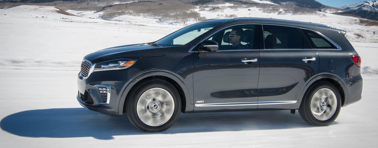 A black 2019 Kia Sorento AWD driving on snow