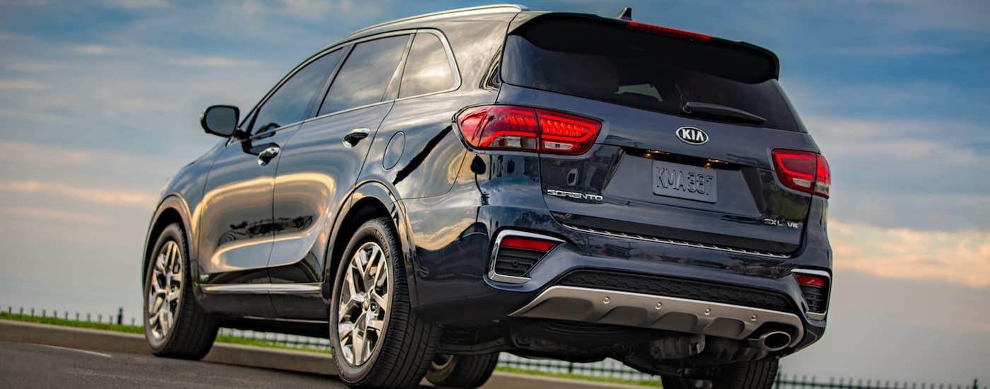 A gray 2019 Kia Sorento facing away from the camera at sunset, found one at a Kia dealership near me.