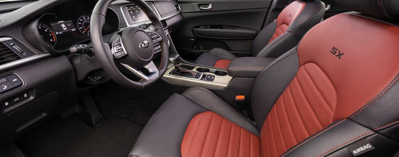 Two-tone red and black seats in a 2019 Kia Optima SX