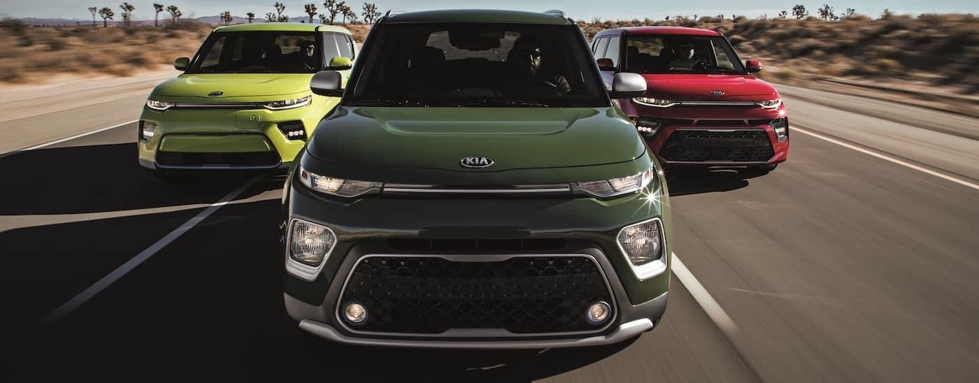 Three 2020 Kia Souls are driving in the desert.