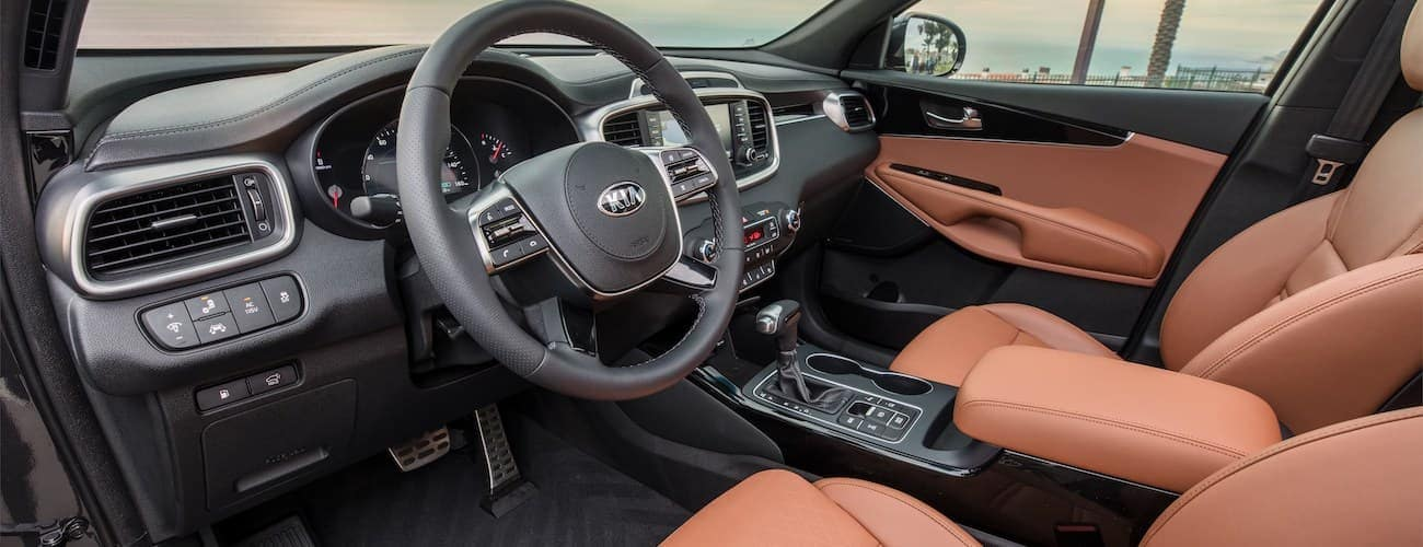 The black and brown interior of the 2020 Kia Sorento is shown.