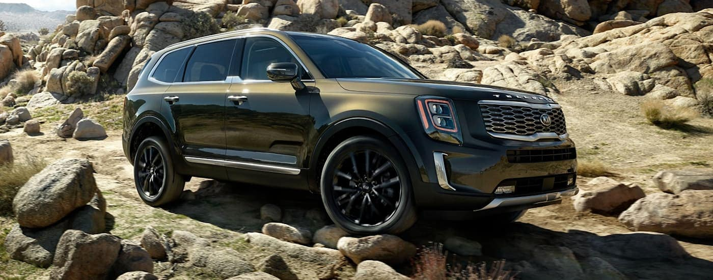A green 2020 Kia Telluride is off-roading outside of Freehold, NJ.