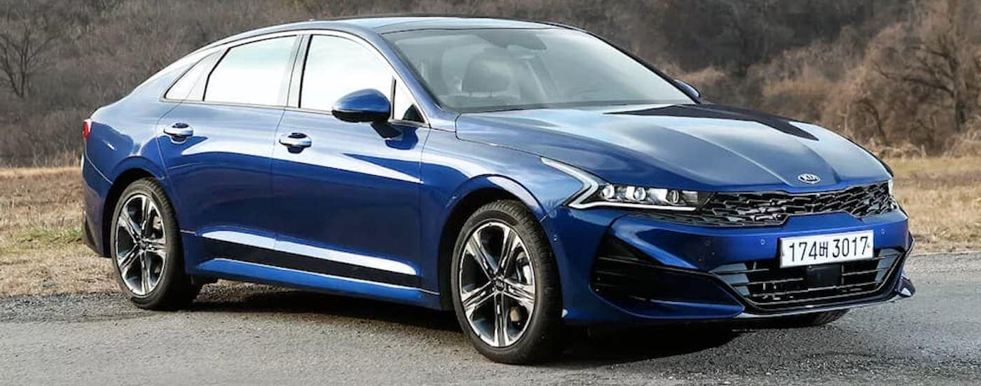 A blue 2021 Kia Optima, designed from the Korean K5, will be available in Freehold, NJ, later in the year.