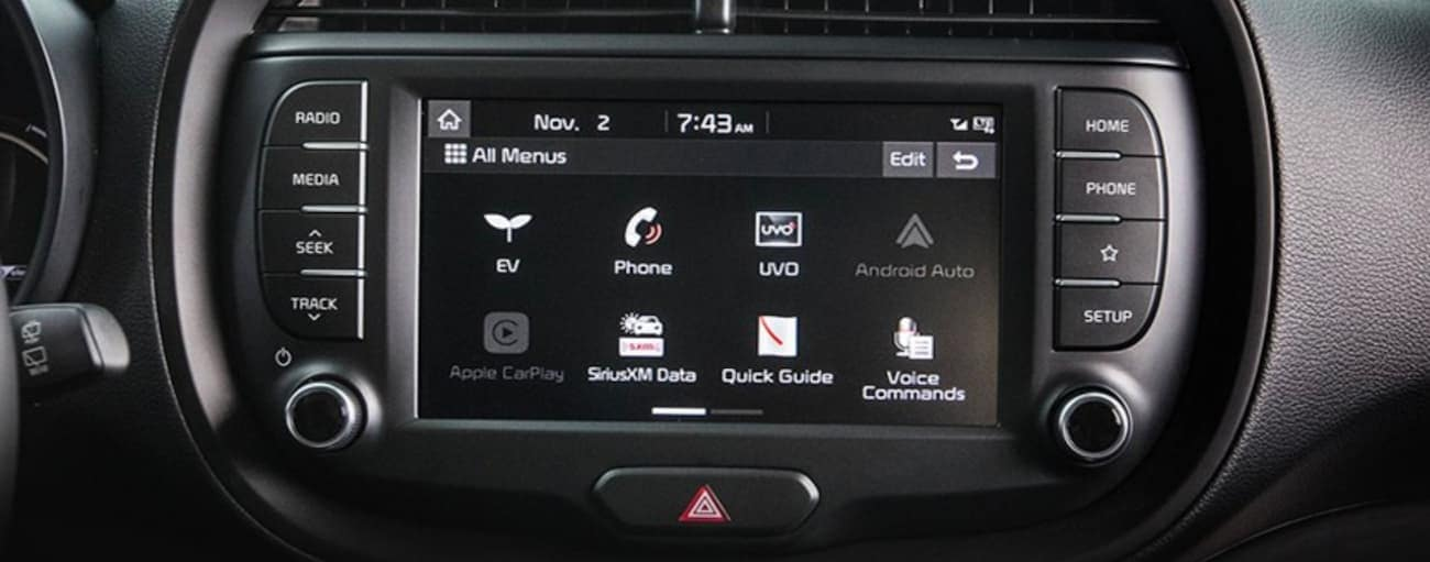 The infotainment screen is shown from a 2021 Kia Soul EV.