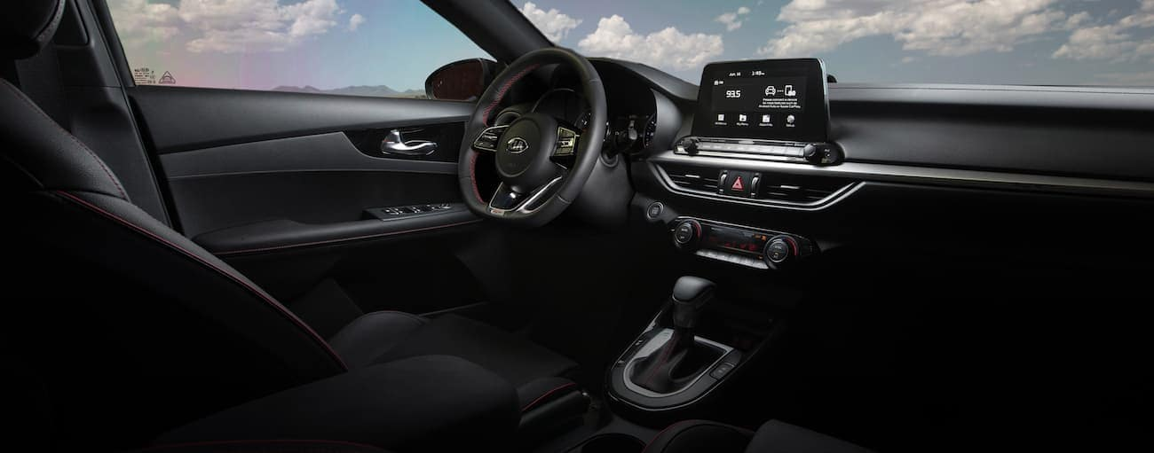 The dashboard and infotainment screen on a 2020 Kia Forte are shown.
