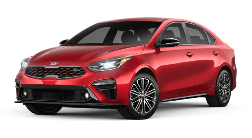 A red 2020 Kia Forte is facing left.