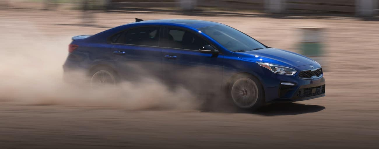 A blue 2020 Kia Forte is racing in the dirt near Freehold, NJ.