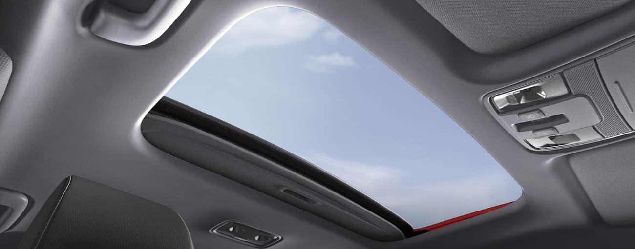 The sunroof is shown in the interior of a 2020 Kia Forte, which wins when comparing the 2020 Kia Forte vs 2020 Toyota Corolla.