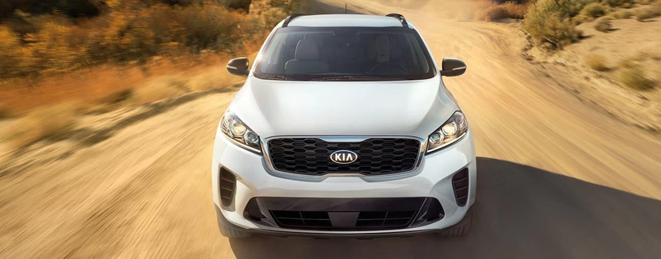A white 2020 Kia Sorento is driving on a dirt road outside of Freehold, NJ.