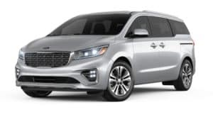 A silver 2021 Kia Sedona is angled left.