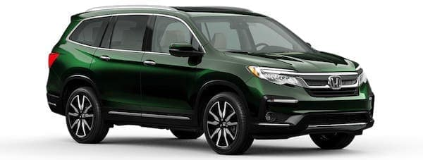 A green 2021 Honda Pilot is angled right.