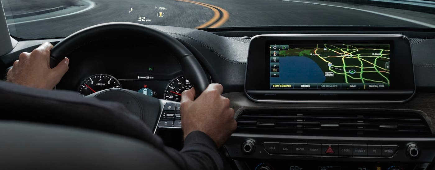 A driver is using the head up display on a 2021 Kia Telluride while driving around a track.