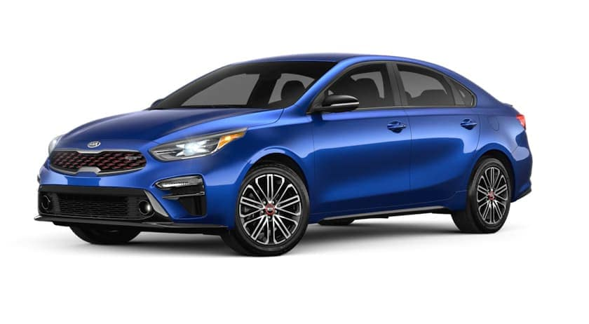 A blue 2021 Kia Forte is angled left.