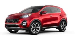 A red 2021 Kia Sportage is angled left.