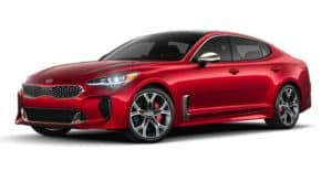 A red 2021 Kia Stinger is angled left.