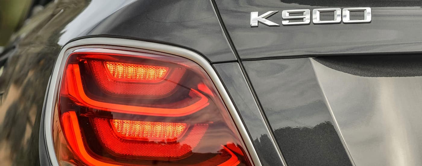 A close up is shown of the tail light and badging on a grey 2020 Kia K900.