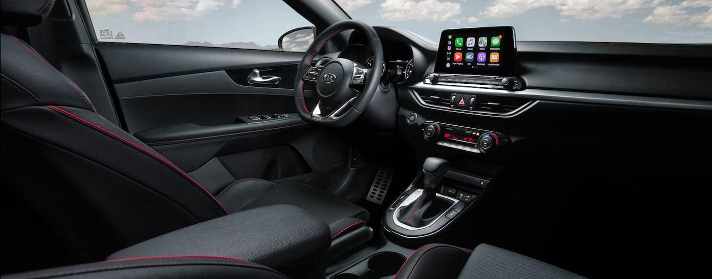 The black interior is shown on a 2021 Kia Forte GT.