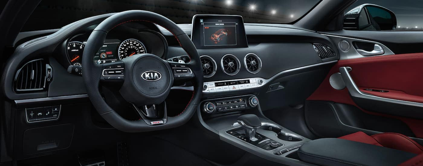 The black and red interior is shown on a 2021 Kia Stinger.