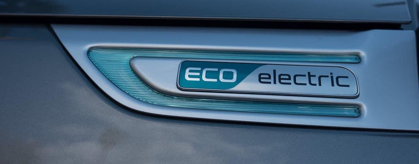 A closeup shows the Eco Electric badging on a Kia Hybrid, a 2019 Kia Soul.