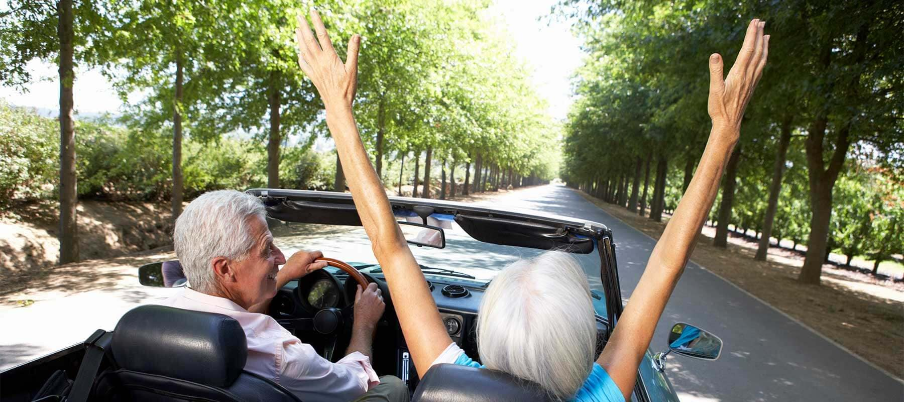 Excited Senior Couple in Convertible