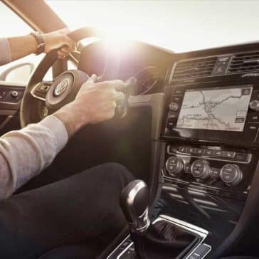 Interior dashboard view of man driving a 2018 Volkswagen Golf GTI