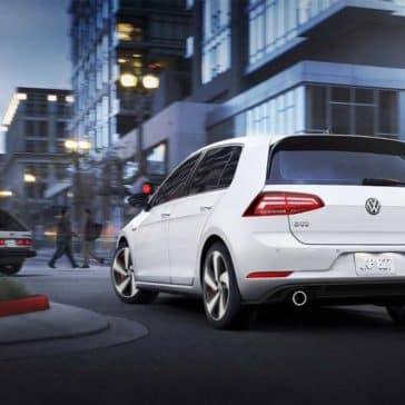 2018 Volkswagen Golf GTI turning a corner on a city street