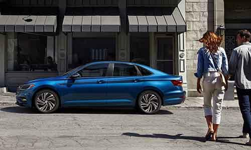 2019 Volkswagen Jetta parked outside a storefront