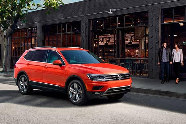 2018 Volkswagen Tiguan Parked Curbside Outside a Restaurant